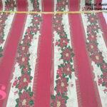 flor-navidad-rayas-rojas-mantel-resinado-antimanchas-navidad-algodon,Mantel Resinado Antimanchas Navidad fondo Rojo