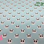 63-telas-estampadas-de-algodón,-telas-floreadas,estampados-floreados-de-algodón,estampados-origonales-de-algodón,Tejido Estampado Caras Panda fondo Azul